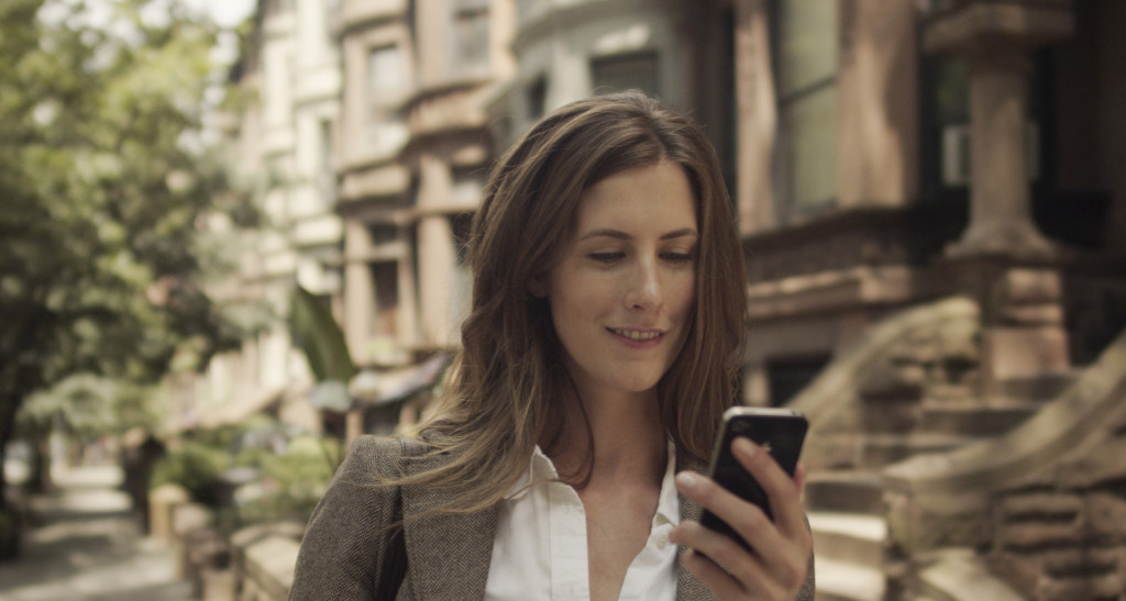 woman checking her canary app while out